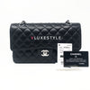 Chanel Classic Black Medium Quilted Double Flap Caviar with silver hardware