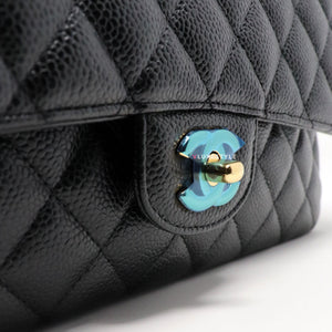 Chanel Classic Medium Double Flap Black Quilted Caviar with gold hardware.