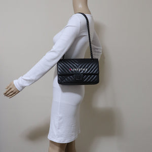 20% Non- refundable downpayment to reserve: Chanel Reissue So Black Chevron Calfskin with shiny black hardware size 225