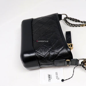 Chanel Small Gabrielle Hobo 20A Black Aged Calfskin with mixed hardware with the new statement strap