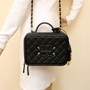 Remaining Balance: Chanel Vanity Case Medium Black Quilted with brushed gold hardware