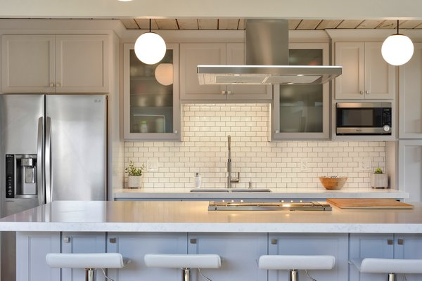 the-kitchen-has-been-updated-with-quartz-countertops-designer-appliances-and-an-island-with-breakfast-bar-seating