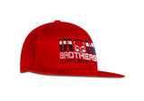 Angled View Of Red Iron Brothers Snapback Cap Hat With Black Company Logo At The Front