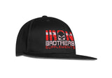 Angled View Of Black Iron Brothers Snapback Cap Hat With Red Company Logo At The Front