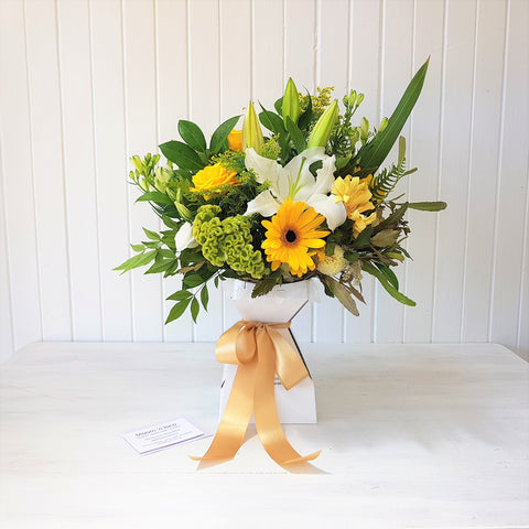 sunshine bouquet in a travel vase