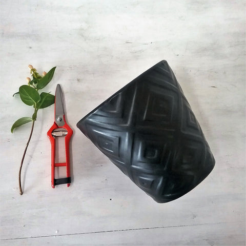 black ceramic pot with geo pattern