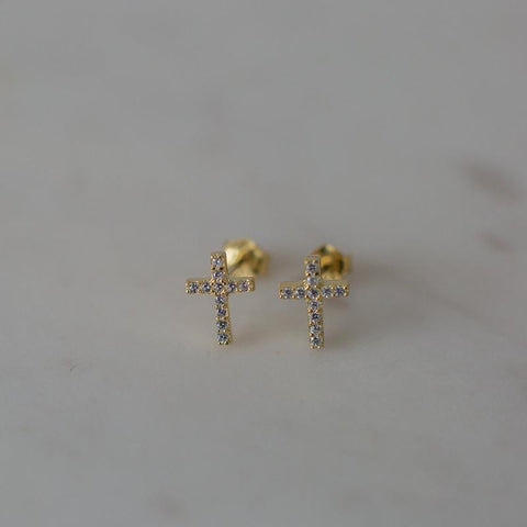 gold sparkle cross studs clear
