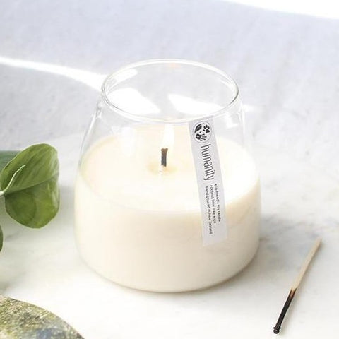 humanity soy candle in glass holder