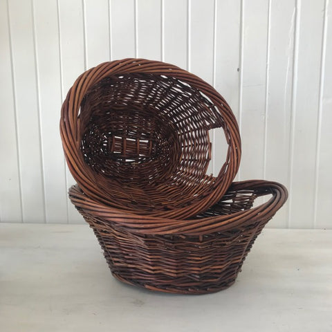 brown oval cane basket