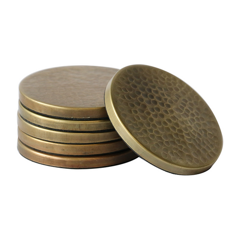 a set of bronze look metal coasters