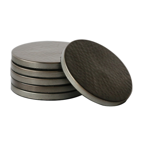 a set of satin grey metal coasters