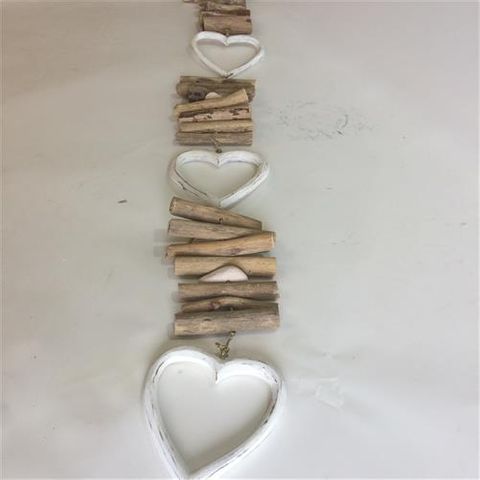driftwood strand with 3 hollow hearts