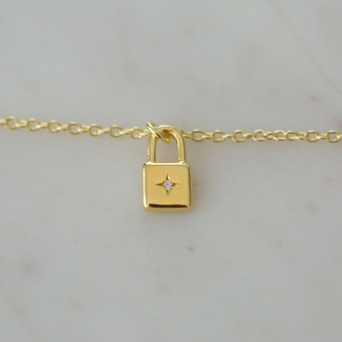gold little lock necklace by Sophie