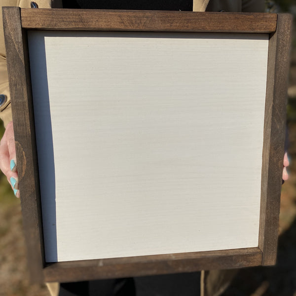 1x1 framed white with dark wood frame