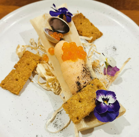 Confit Salmon Mousse, Ora King Caviar, Chickpea Crackers and Violas from Chef Kieran Jr Genge of 4 1/2 Grams