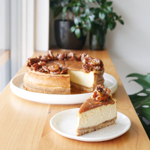 Delicious baked cheesecake with vanilla bean, salted caramel and candied pecans