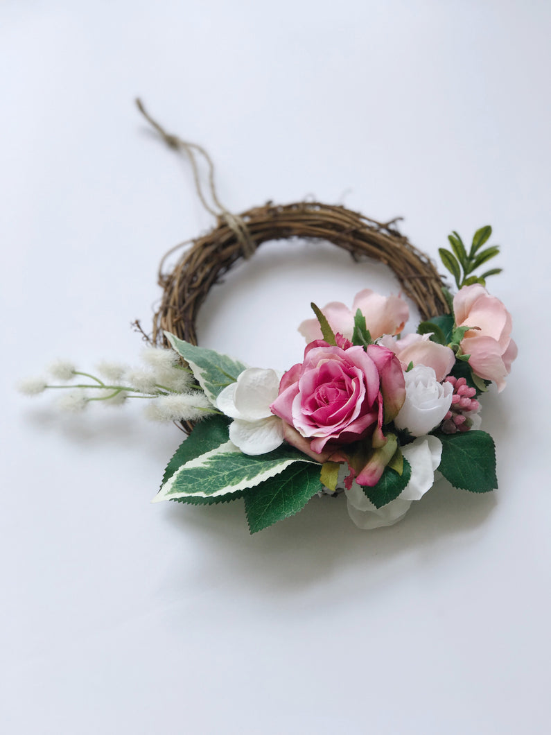 Pink floral grapevine wreath