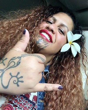 Marlo Lualemana designed a tattoo for a NA KOA Leather cuff bracelet