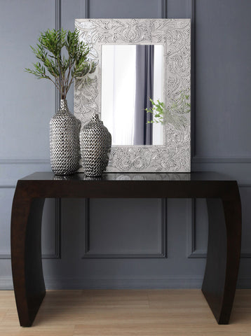 decorative mozaic mirror and vases on accent table