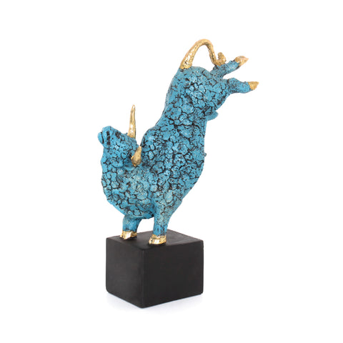 larger turquoise bull figurine with gold accents and a black base