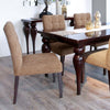 tufted dining chair with a parsons style with wooden legs next to a glossy dining table