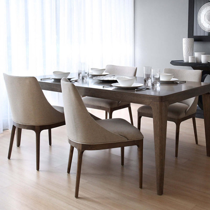 contemporary dining chair with straight wooden legs and a low backrest dining table view