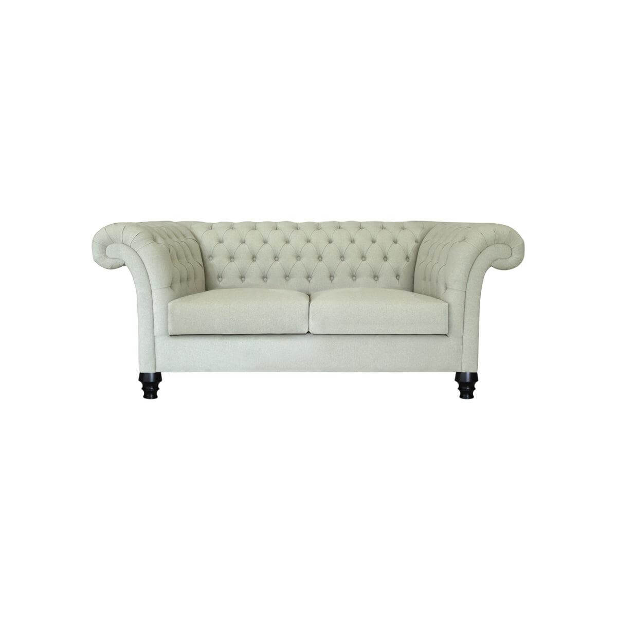 tufted two seat sofa with satin finished legs