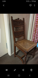 Antique handcarved hardwood chairs with rattan seat.