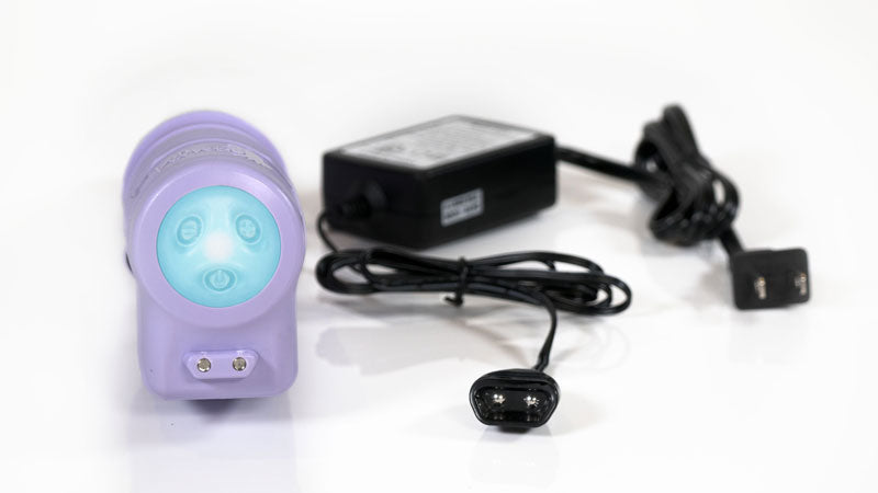 The thruster rechargeable sex machine with its charger
