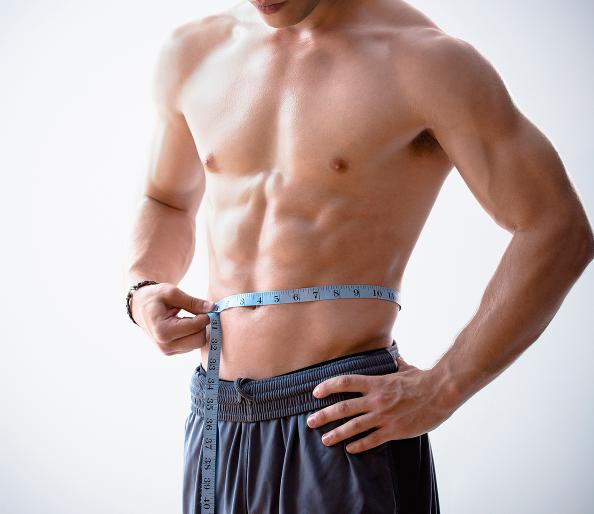 man_measuring_waist_body_fat_main