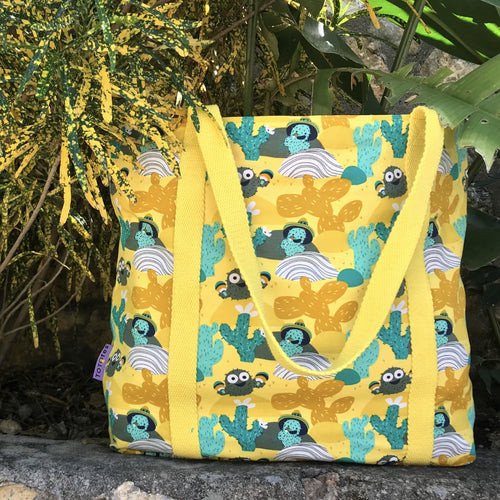 Embrace nature and the fun loving summer vibes with this bright yellow cactus print shopper bag! Just remember, if you do find yourself in the desert don't go trying to drink water from any random cactus you see because chances are it'll just give you some seriously bad indigestion! So stay hydrated, grab this awesome bag and go out there and have a blast!