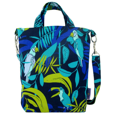 This jungle inspired bag features a blue green print made up of parrots and toucans against tropical leaves in the background.