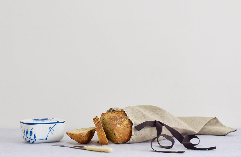 royal copnehagen - blue fluted mega | iris hantverk - scandinavian design - nordic living - sustainable design - handmade - linen bread bag - pure linen - sourdough - kitchen table