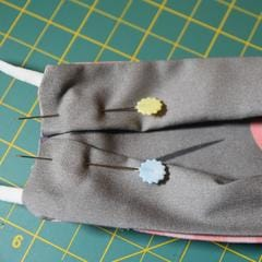 Pin pleats on sides of mask