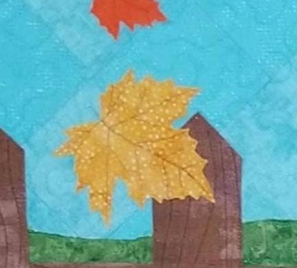 Fence post and leaf