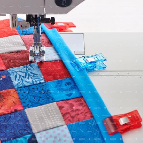 bias clips holding quilt binding