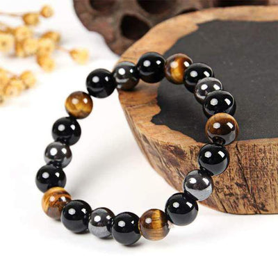 PROTECTION, HEALING AND POWER Bracelet in black obsidian, tiger's eye and hematite.