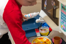 Kids using Truce All-Purpose Cleaner on their play kitchen items