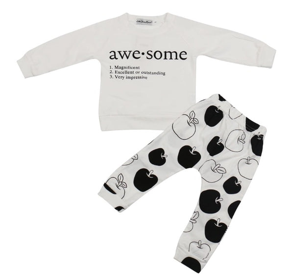 "Awesome apples!  What a great monochromatic outfit!  Breathable cotton; this baby outfit consists of white legging style pants with black apple print, and a white long sleeve sweatshirt with the slogan ""Awesome"" on the front."