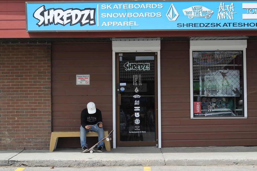 Owner of Shredz Skateshop outside the store