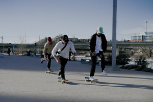 Thankyou Group skateboarders pushing in Calgary Banner