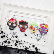 Load image into Gallery viewer, Halloween Skulls - glow in the dark - Handmade Flatback Clay Bow Centre