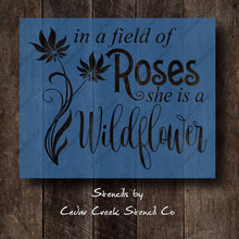 Load image into Gallery viewer, In a field of roses she is a wildflower quote stencil, Reusable Stencil, inspirational stencil, Flower stencil, craft stencil for signs - Cedar Creek Stencil Co.