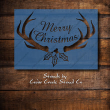 Load image into Gallery viewer, Merry Christmas Antlers Stencil, Reusable stencil, Paint Stencil, Rustic Christmas, Christmas Craft Stencil, DIY Christmas Decor Stencil - Cedar Creek Stencil Co.