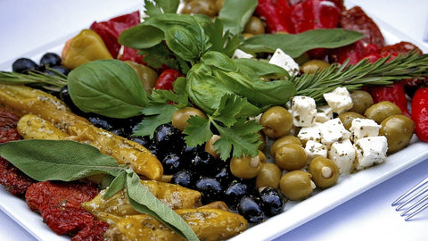 Healthy buffet with olives, cheese and greens