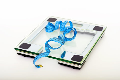Scale and measuring tape used for weight loss