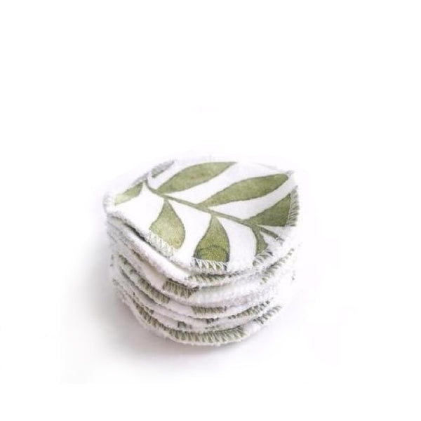 Stacked set of reusable bamboo cotton rounds in green ivory colour