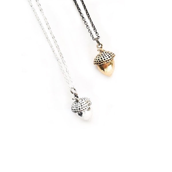 Silver and gold-plated acorn necklaces hanging