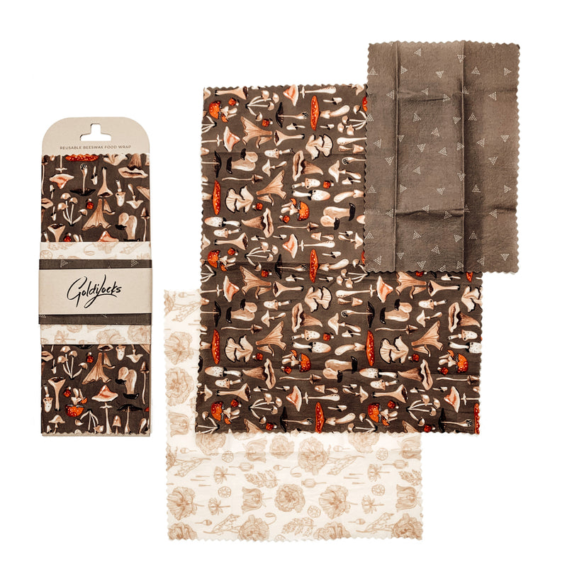 Set of 3 mushroom and floral beeswax wraps laid out to display the large, medium and smalls wraps