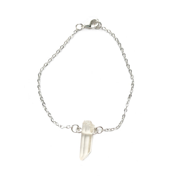 A raw crystal bracelet against a white background